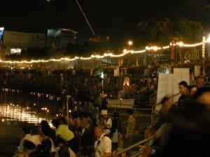 people releasing Krathongs in Ping river Chiang Mai