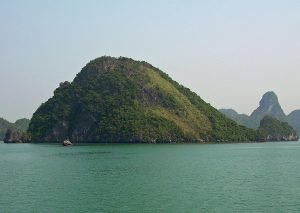 limestone karst isles while Ha Long Bay boat sailing