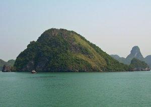 limestone karst isles while Ha Long Bay boat sailing