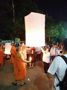 lighting Khom Loy lanterns at Loy Krathong festival