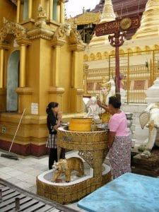 pouring water over Buddha image Yangon