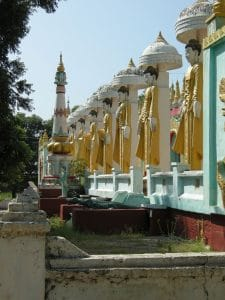 entrance of temple with identical Buddhas