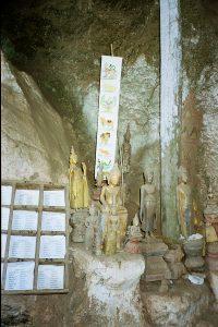 Pak Ou caves with miniature Buddha sculptures