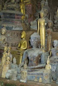 ancient Buddha sculptures Pak Ou caves