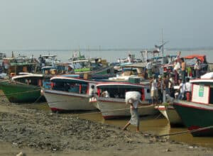 boats along the shore of the Irrawaddy river in Mandalay