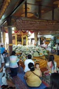 making fortune wishes to the Buddha of Success at Wat Doi Kham