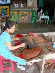 girl making incense in Hue