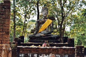 meditating Buddha at temple hill in Si Satchanalai