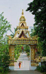 monk leaving Wat That Luang