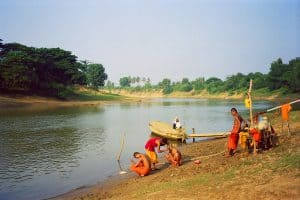 monks shaving at river near Battambang