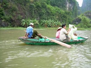 in a row boat to Tam Coc