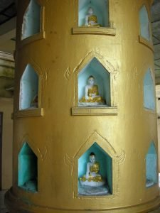 round shrine with Buddha statues at Mount Popa hill