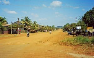 main city road: chewing sand in Banlung