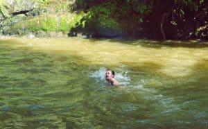 swimming at Ka Chanh waterfall near Banlung